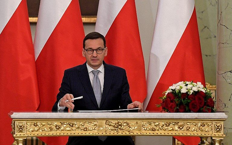 Poland's new prime minister sworn in with old Cabinet