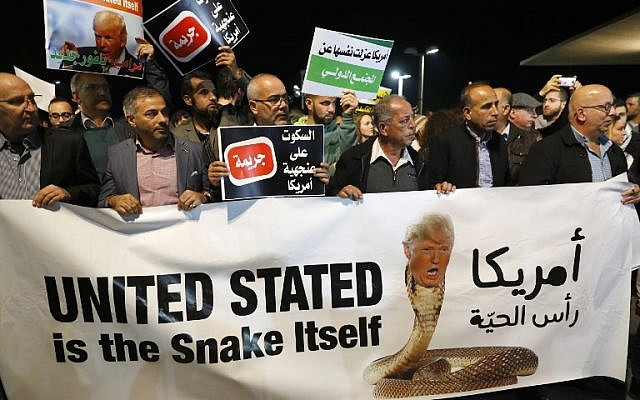 Arab Israelis take part in a protest outside the American embassy in Tel Aviv against US President Donald Trump's decision to recognize Jerusalem as Israel's capital on December 12, 2017. (AFP Photo/Jack Guez)