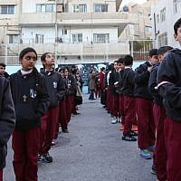 Iraqi Christian students line up at the Latin Patriarchate school in the Marka district in the eastern part of Jordan's capital Amman on December 12, 2017. (AFP Photo/Khalil Mazraawi)