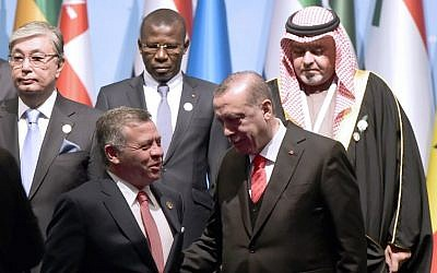 Turkish President Recep Tayyip Erdogan (front row, R) speaks with Jordan's King Abdullah as they pose for a group photo during an Extraordinary Summit of the Organization of Islamic Cooperation (OIC) on last week's US recognition of Jerusalem as Israel's capital, on December 13, 2017 in Istanbul. (AFP PHOTO / YASIN AKGUL)