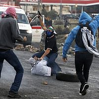Undercover Israeli policemen detain Palestinian protestors during clashes in the West Bank city of Ramallah on December 13, 2017. (Abbas Momani/AFP)