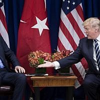 This file photo taken on September 21, 2017 shows US President Donald Trump reaching to shake Turkey's President Recep Tayyip Erdogan's hand before a meeting at the Palace Hotel during the 72nd United Nations General Assembly in New York City. (AFP PHOTO / Brendan Smialowski)
