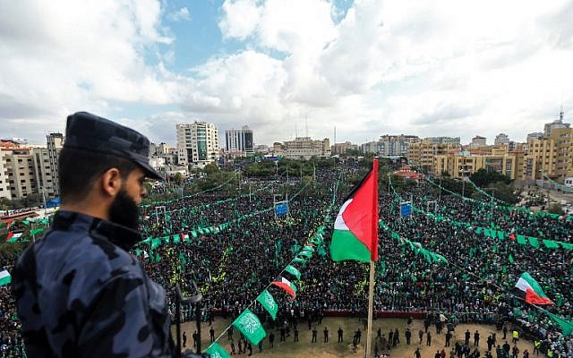 Hamas supporters take part in a rally marking the 30th anniversary of the founding of the Islamist terror movement, in Gaza City, on December 14, 2017. (MOHAMMED ABED / AFP)