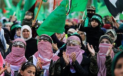Illustrative: Hamas supporters take part in a rally marking the 30th anniversary of the founding of the Islamist terror movement, in Gaza City, on December 14, 2017.  (Mohammed Abed/AFP)