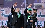 Hamas leader Ismail Haniyeh (L) and Hamas's leader in the Gaza Strip Yahya Sinwar wave during a rally marking the 30th anniversary of the founding of the Islamist terror movement, in Gaza City, on December 14, 2017. (Mohammed Abed/AFP)