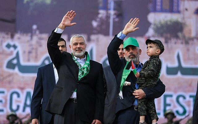 Hamas leader Ismail Haniyeh (L) and Hamas's leader in the Gaza Strip Yahya Sinwar wave during a rally marking the 30th anniversary of the founding of the Islamist terror movement, in Gaza City, on December 14, 2017. (MOHAMMED ABED / AFP)