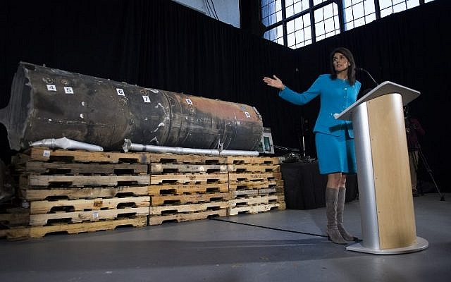 Illustrative: US Ambassador to the United Nations Nikki Haley points to previously classified missile segments she says prove Iran violated UN Security Council Resolution 2231 by providing the Houthi rebels in Yemen with arms, during a press conference at Joint Base Anacostia in Washington, DC, on December 14, 2017. (AFP Photo/Jim Watson)