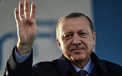 Turkish President Recep Tayyip Erdogan makes a four-finger (rabia) sign during a speech in Istanbul, December 15, 2017. (Ozan Kose/AFP)