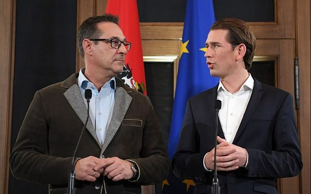 Leader of Austria's conservative People's Party Sebastian Kurz (R) and the Chairman of the Freedom Party Heinz-Christian Strache give a joint press conference in Wien, Austria, on December 15, 2017. (AFP Photo/APA/Roland Schlager)