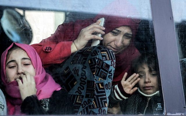 A Palestinian woman and child bid farewell through the window of a bus in Khan Younis in the southern Gaza strip on December 16, 2017, prior to their departure for the Rafah border crossing with Egypt. (AFP Photo/Said Khatib)
