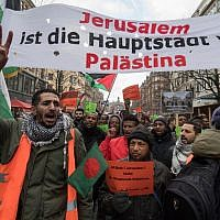 Protesters hold a banner reading 'Jerusalem is the capital of Palestine' during a demonstration of members of the Palestinian community on December 16, 2017 in Frankfurt am Main, to protest against the US decision to recognize Jerusalem as Israel's capital. (AFP/dpa/Boris Roessler)