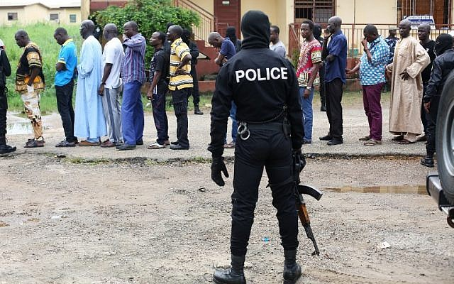 Following a knife attack on two Danish nationals, police question detained Muslim retail traders in Libreville, Gabon, December 17, 2017. (Steve JORDAN/AFP)