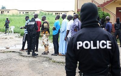 Police question detained Muslim retail traders on December 17, 2017 in Libreville, following a knife attack on two Danish nationals.  (AFP PHOTO / Steve JORDAN)