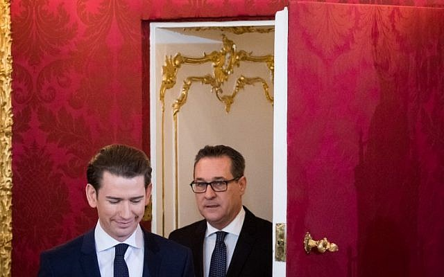 Austrian Chancellor Sebastian Kurz (L) and Vice Chancellor (FPOe) Heinz Christian Strache arrive for the swearing-in ceremony of the new government in Vienna on December 18, 2017. (AFP Photo/Vladimir Simicek)
