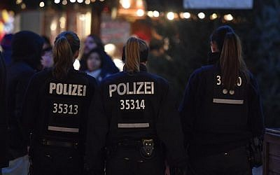 Illustrative: Policewomen patrol at the Christmas market at Breitscheidplatz near the Kaiser-Wilhelm-Gedaechtniskirche (Kaiser Wilhelm Memorial Church) in Berlin one day ahead of the anniversary of last year's deadly truck attack in Berlin, on December 18, 2017. (AFP Photo/John MACDOUGALL)