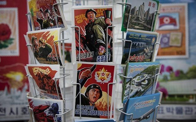 In a photo taken on November 15, 2017, military-themed postcards are displayed at a shop in central Pyongyang. (AFP PHOTO / Ed JONES)