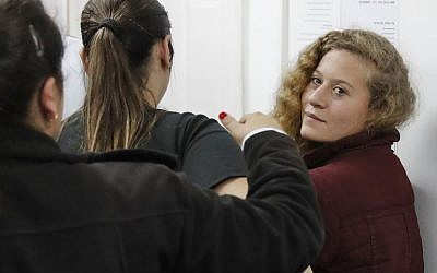 Palestinian Ahed Tamimi, 17, a well-known agitator against Israel, appears for a remand hearing at a military court at the Israeli-run Ofer prison in the West Bank village of Betunia on December 20, 2017. (AFP PHOTO / Ahmad GHARABLI)