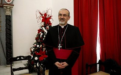 Archbishop Pierbattista Pizzaballa, Apostolic Administrator of the Latin Patriarchate of Jerusalem, stands at the end of the annual pre-Christmas press conference at the Latin Patriarchate headquarters in the old city of Jerusalem on December 20, 2017. (AFP PHOTO / GALI TIBBON)