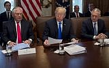 US President Donald Trump, center, holds a Cabinet Meeting alongside Secretary of State Rex Tillerson, left and Secretary of Defense Jim Mattis in the Cabinet Room at the White House in Washington, DC, December 20, 2017. (AFP/ SAUL LOEB)