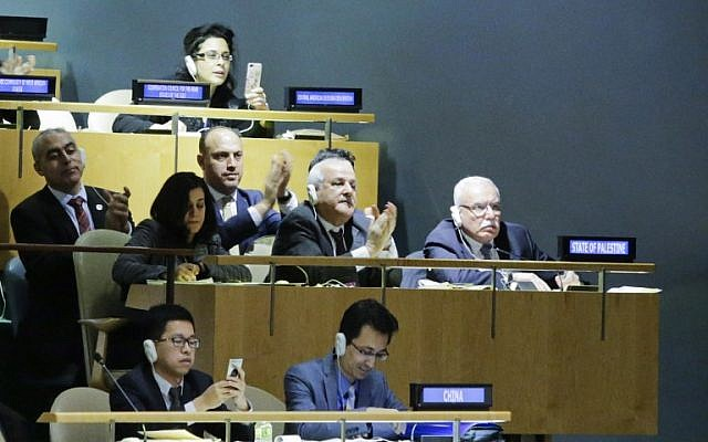 Illustrative: Riyad H. Mansour (C), The Palestinian Ambassador to the United Nations, and his delegation members celebrate the results of the vote on Jerusalem at the General Assembly hall, on December 21, 2017, at UN Headquarters in New York. (AFP PHOTO / EDUARDO MUNOZ ALVAREZ)