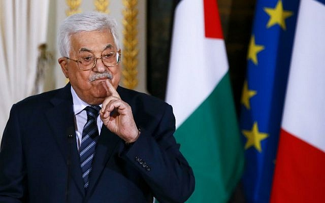 Palestinian Authority President Mahmoud Abbas gestures as he speaks during a joint press conference with French president following their meeting at the Elysee presidential Palace, in Paris, on December 22, 2017. (AFP/Pool/Francois Mori)
