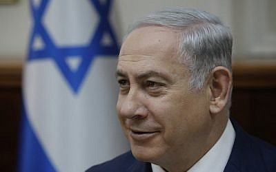Prime Minister Benjamin Netanyahu is seen at the weekly cabinet meeting at the Prime Minister's Office in Jerusalem on December 24, 2017. (AFP Photo/AFP Photo and Pool/Amir Cohen)