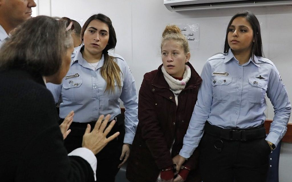 Ahed Tamimi (2nd-R) appears at the military court at the West Bank's Ofer prison on December 25, 2017. (AFP Photo/Ahmad Gharabli)