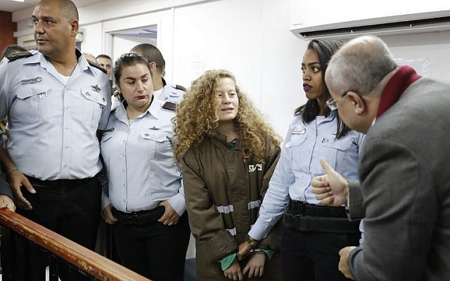 Palestinian activist Ahed Tamimi appears at a military court at the Israeli-run Ofer prison in the West Bank village of Betunia on December 28, 2017 (AFP PHOTO / Ahmad GHARABLI)