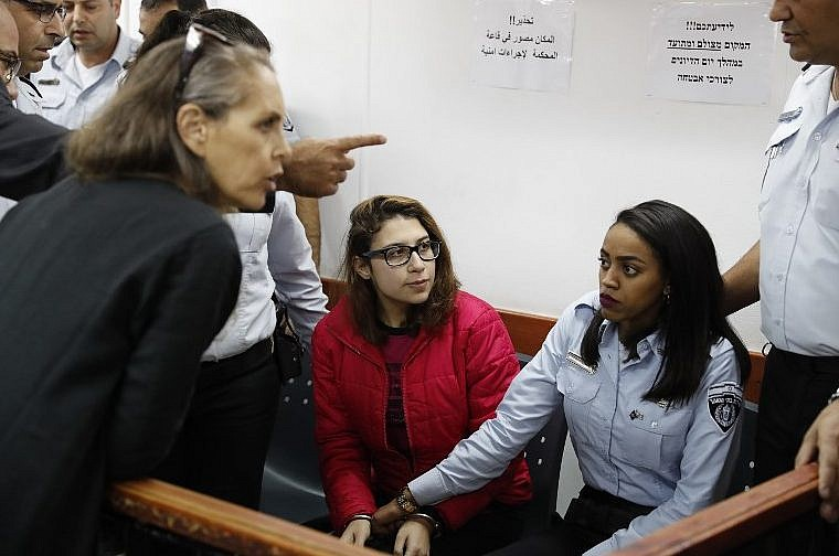 Palestinian girl filmed slapping Israeli soldier is charged with assault