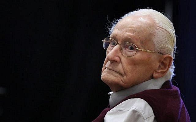 "This photo taken on July 1, 2015 shows defendant and German former SS officer Oskar Groening, dubbed the ""bookkeeper of Auschwitz"", at court in Lueneburg, northern Germany, ahead of his trial. (2017. / AFP PHOTO / RONNY HARTMANN)"