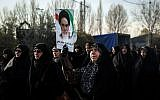 Iranians chant slogans as they march in support of the government near the Imam Khomeini grand mosque in the capital Tehran on December 30, 2017. Tens of thousands of regime supporters marched in cities across Iran in a show of strength for the regime after two days of angry protests directed against the country's religious rulers.  (AFP PHOTO / TASNIM NEWS / HAMED MALEKPOUR)