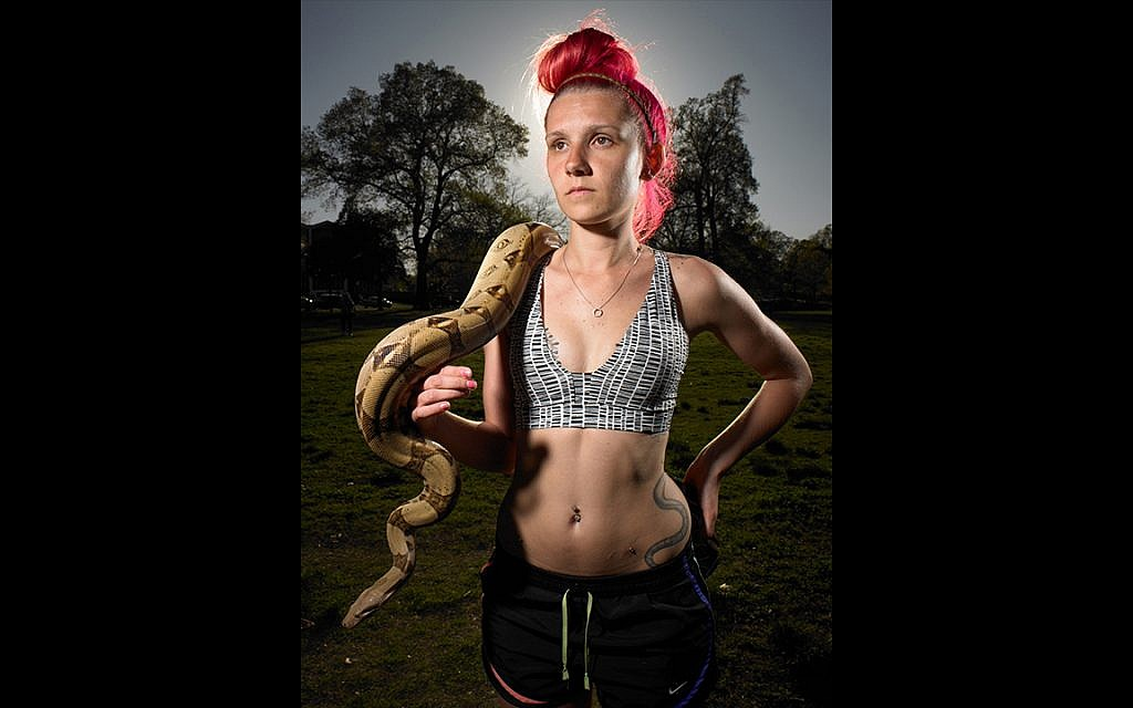 Millennial Lilly Elkin with her pet snakes Eago and Cleo. Overland Park in Memphis, Tennessee. Voted for Donald Trump. Shot April 1st, 2017. (Naomi Harris)
