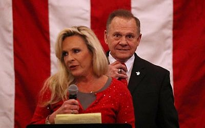 Republican Senate candidate Roy Moore stands behind his wife Kayla Moore as she speaks during a campaign event at Jordan's Activity Barn on December 11, 2017, in Midland City, Alabama. (Joe Raedle/Getty Images/AFP)