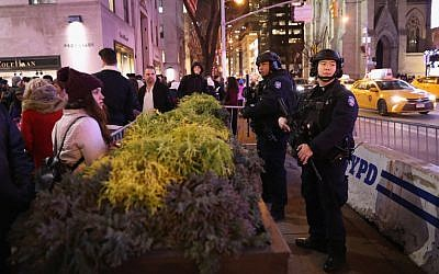 Police stand guard near the Rockefeller Center Christmas tree on December 12, 2017, in New York City. (John Moore/Getty Images/AFP