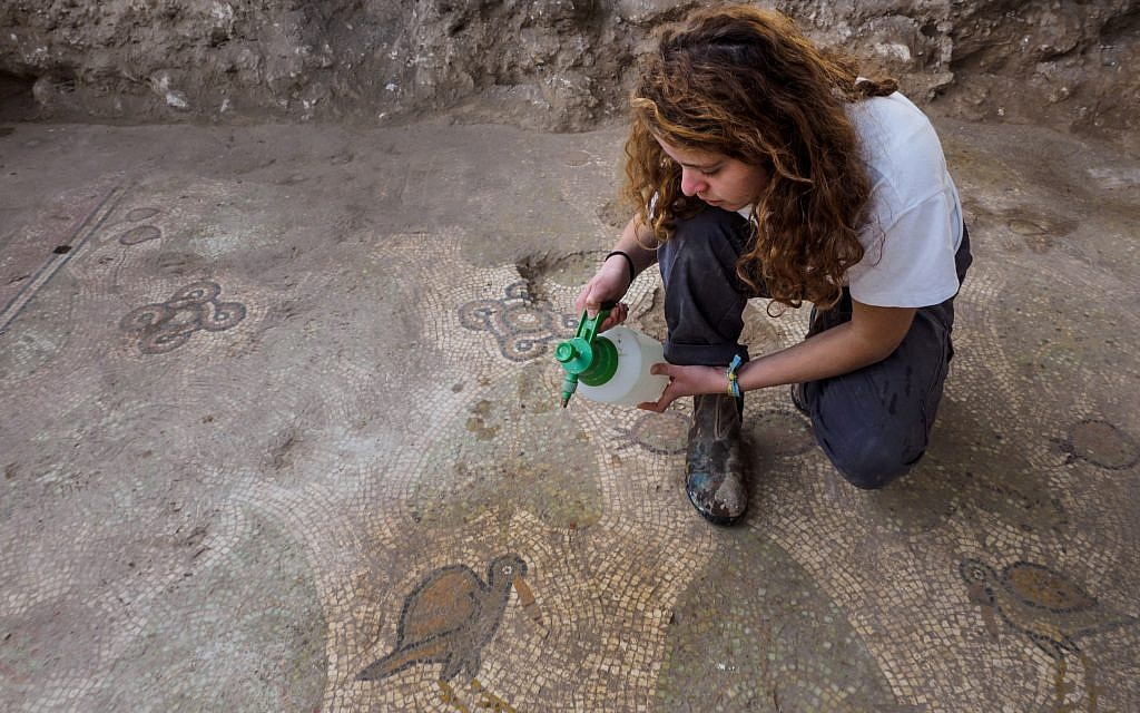 Excavating the mosaic floor at a Byzantine-period church complex found in Ramat Beit Shemesh, 2017. (Assaf Peretz, Israel Antiquities Authority)