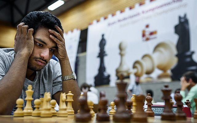 Illustrative: A chess player stares at a board during a competition on July 27, 2017. (schaakbond/Flickr/CC BY 2.0)