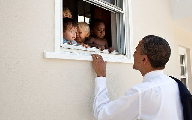 President Barack Obama greets children at a day care facility adjacent to daughter Sasha's school in Bethesda, Md., following her 4th grade closing ceremony, June 9, 2011. (White House/Pete Souza)