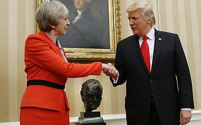 US President Donald Trump shakes hands with British Prime Minister Theresa May in the Oval Office of the White House in Washington on January 27, 2017. (AP/Pablo Martinez Monsivais)