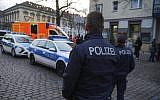 Illustrative: Police close the streets around a Christmas market after a suspicious object was found in Potsdam, Germany, on Dec. 1, 2017. (Julian Staehle/dpa via AP)