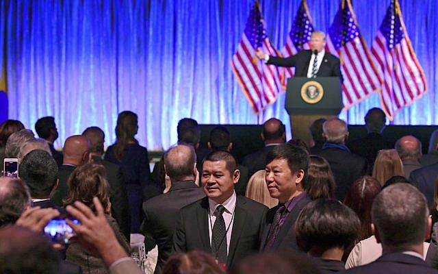 People in the audience have their photo taken as President Donald Trump speaks at a fundraiser at Cipriani in New York, Saturday, Dec. 2, 2017 (AP Photo/Susan Walsh)
