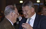 The new elected party chairmen Joerg Meuthen, right, and Alexander Gauland shake hands during a party convention of the Alternative for Germany, AfD, party in Hannover, Germany, Saturday, Dec. 2, 2017. (AP Photo/Michael Sohn)