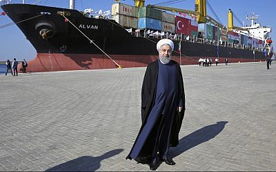 Iranian President Hassan Rouhani poses during the inauguration of a newly built extension of the port of Chabahar, near the Pakistani border, on the Gulf of Oman, southeastern Iran, December 3, 2017. (Ebrahim Noroozi/AP)