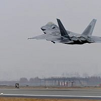 A US Air Force F-22 Raptor takes off from a South Korean air base in Gwangju, South Korea, on December 4, 2017. (Yonhap via AP)