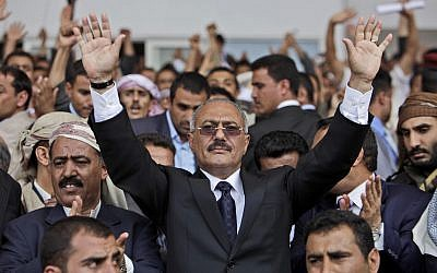 In this April 15, 2011, photo then Yemeni President Ali Abdullah Saleh waves to supporters in Sana'a, Yemen. (AP Photo/Muhammed Muheisen)