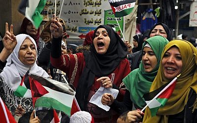 Palestinian women chant slogans as they hold Palestinian flags during a sit-in in the Bourj al-Barajneh Palestinian refugee camp, in Beirut, Lebanon, December 6, 2017. (AP Photo/Bilal Hussein)