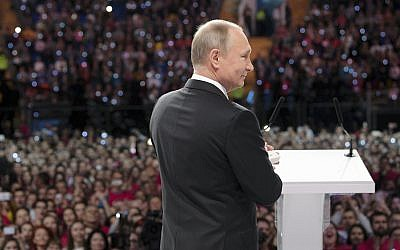 Russian President Vladimir Putin attends the annual Volunteer of Russia 2017 award ceremony at the Megasport Sport Palace in Moscow, Russia, December 6, 2017.(Alexei Druzhinin, Sputnik, Kremlin Pool Photo via AP)