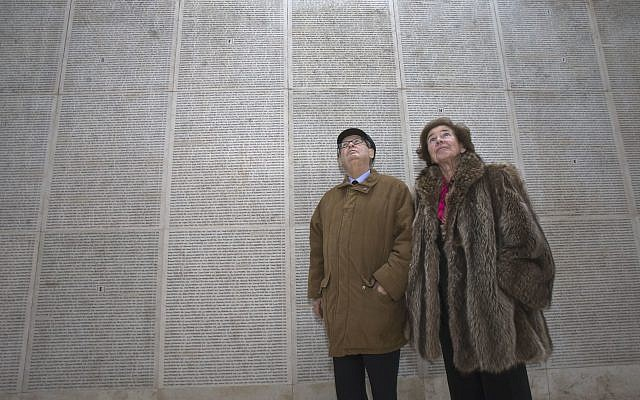 In this photo taken on December 5, 2017, French Nazi hunters Serge Klarsfeld, (l) and his wife Beate look at the Wall of Names at the Shoah Memorial in Paris. (AP Photo/Michel Euler)