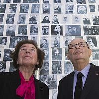 In this December 5, 2017 photo, French Nazi hunters Beate Klarsfeld (l) and her husband Serge look at at photos of young Jews deported from France at the Shoah Memorial in Paris, France. (AP Photo/Michel Euler)