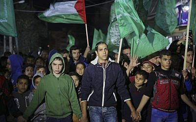 Hamas supporters wave their green flags during a protest against the possible US decision to recognize Jerusalem as Israel's capital, in Jebaliya Refugee Camp, Gaza Strip, Wednesday, Dec. 6, 2017. (AP Photo/Adel Hana)