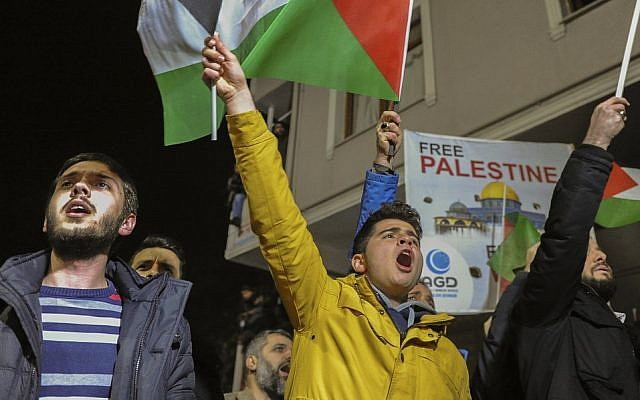 Protesters, some waving Palestinian flags chant anti-US slogans during a demonstration near the US Consulate in Istanbul, late Wednesday, Dec. 6, 2017. (AP Photo/Omer Kuscu)